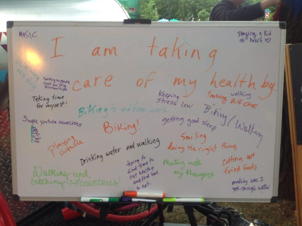A board that has examples of what people are doing to take care of their health.