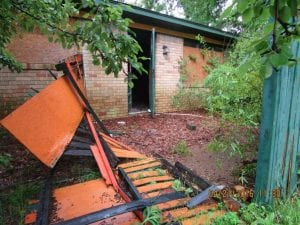 dilapidated home's front entrance