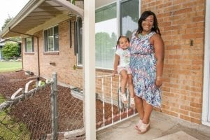 An African-American woman and her daughter stand outside of their Portland home, which is a community land trust home. Portland's preference policy gives priority for homeownership opportunities funded by the city's housing bureau to residents who were displaced.
