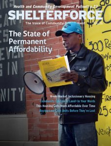 """The front cover of the Spring 2018 edition of Shelterforce magazine. It shows an African-American man speaking through a bullhorn. The theme is """"The State of Permanent Affordability."""""""