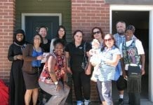 The first community justice land trust tenants at Grace Townhomes. Photo courtesy of DHCD