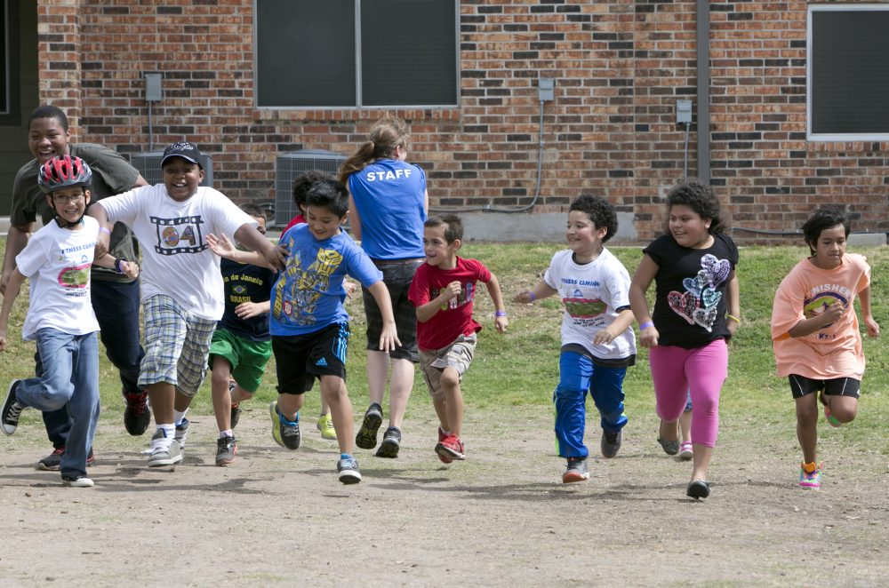 Children learn healthy behaviors at Foundation Communities' free after-school program. Here they are seen running in a race.