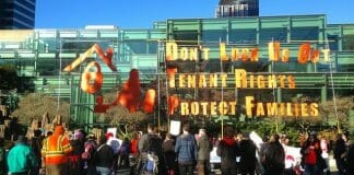 tenants rights protesters and sign