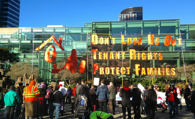 Tenants rights protesters and sign.