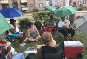 Residents in a mixed income area gather together outside.