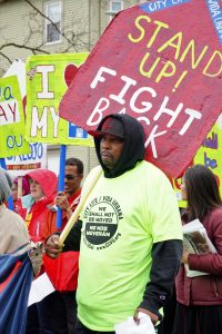 In Boston, a resident marches against a building eviction in 2017.