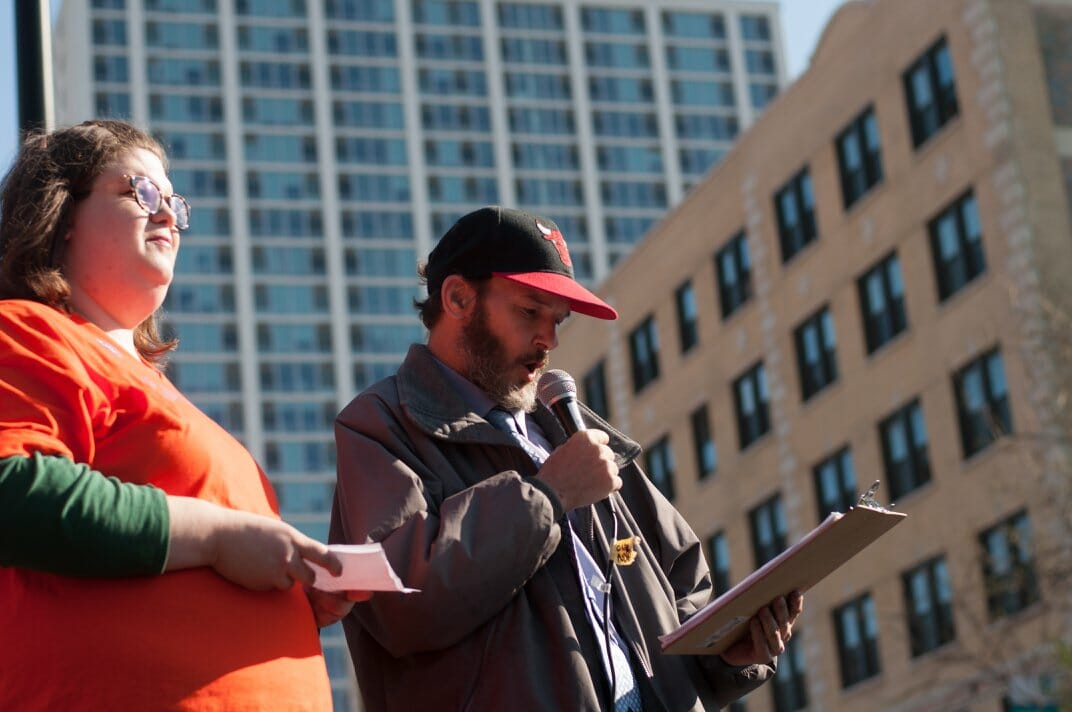Chicago resident Tom Gordon speaks to a crowd. He, as well as other organizers, are fighting for a citywide community benefits campaign.