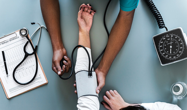 physician takes blood pressure