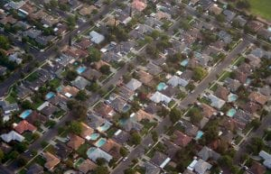 An aerial shot of California homes. Focusing on exclusionary policies in California is important because it was a primary frame used by the proponents of last year's embattled SB-827 legislation, despite the fact that many if not most of the areas that would have been affected by the bill were historically working class and immigrant communities of color.