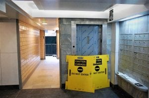 A yellow out of order sign blocks an elevator at the Ocean Bay Apartments complex.