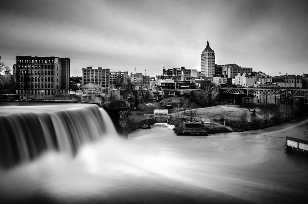 Downtown Rochester, New York, with the Genesee River flowing through the city. In the 90s, Rochester children had high levels of lead in their blood. Decades later, the lead poisoning rate decreased by 85%.