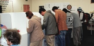 voters in booths