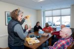 Seniors at a workshop on creating winter bird feeders
