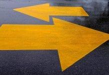 yellow arrows painted on sidewalk