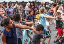 Kids dance at a neighborhood street festival