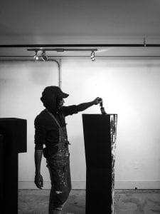 man painting a box