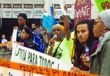 Lisa Owens, executive director of the housing justice organization City Life/Vida Urbana, led an interruption of the YIMBYtown national conference.