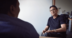 David Moreland, a resident of Stephens Creek Crossing in Oregon, speaks with Home Forward's resident and community service coordinator about building his credit by reporting his rent payments to the three major credit bureaus.