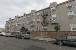 An exterior view of Kensington Gardens, a 41-unit apartment building in East Oakland. Several key organizations are working to take funding from health care systems to a new level.