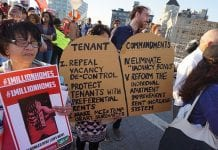 People at a rent-reform rally in New York City, 2015