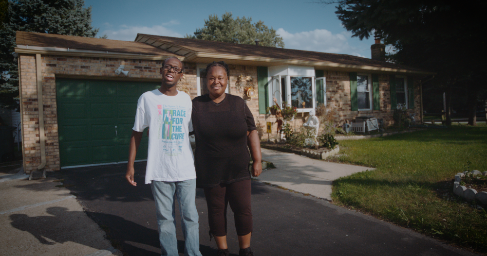 ProMedica and LISC have teamed up to improve health outcomes for residents, including for this Ohio family. The mother, at right, stands with her son in front of the new home she was able to purchase.