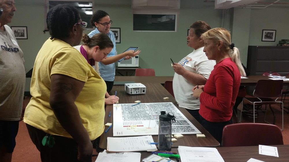 LUCHA members, who worked on a Health Action Plan with a local health provider, holds a focus group meeting.