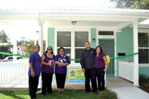 Ribbon cutting for GNDC community land trust home