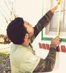 Man measures a window