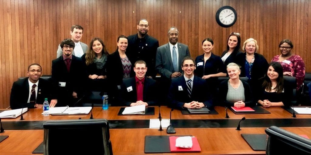 group photo of former foster care youth with HUD Secretary Ben Carson.