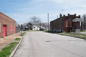 street with boarded commercial space