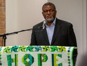 Bill Bynum, CEO and president of HOPE in the Mississippi Delta, speaks at a podium about rural communities.