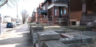row of dark brick houses