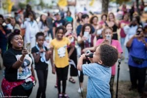 night out crowd watches child perform