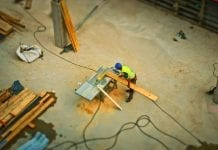 aerial view of construction worker sawing board