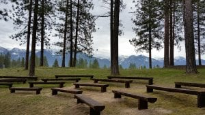 Outdoor seating, with nature surrounding the area. This is an outdoor classroom at Salish Kootenai College.