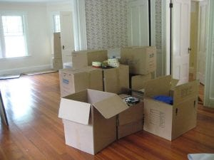 moving boxes in empty apartment