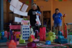 A model of Brownsville, Texas, with people in the back.