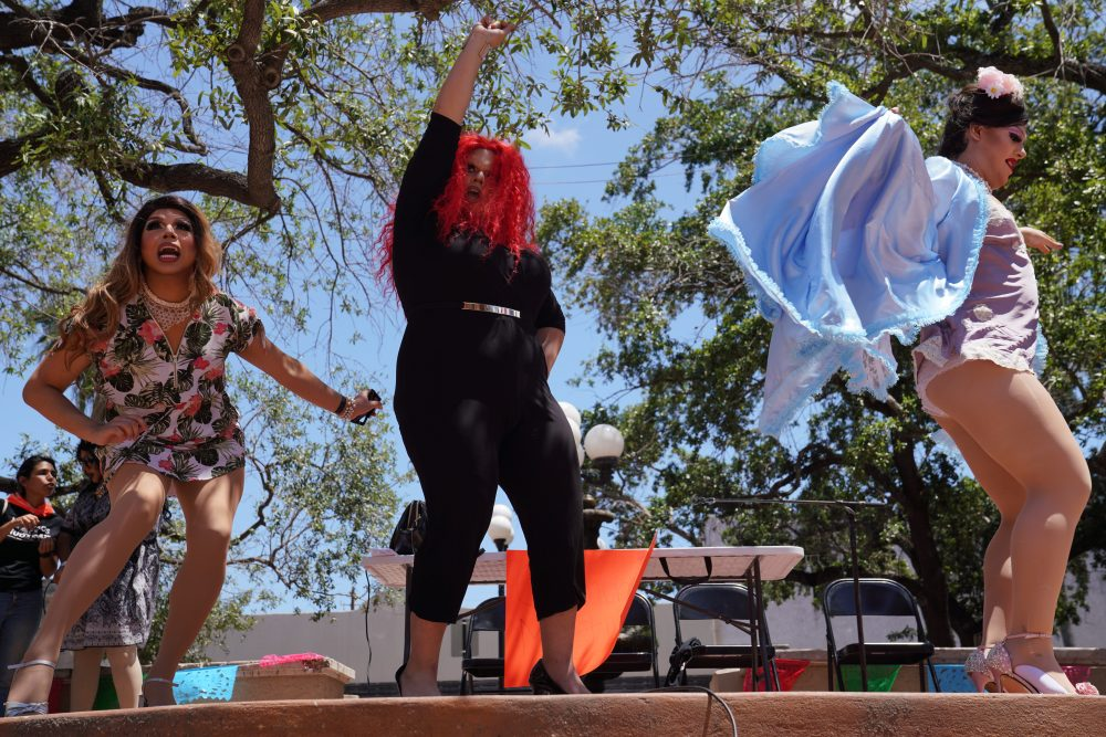 Dragtivists perform on stage at a Brownsville, Texas, event.