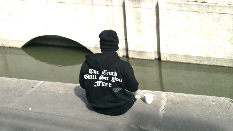 Person in sweatshirt with positive message, asset based
