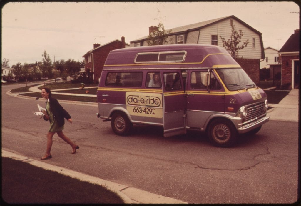 A passenger is dropped off by a dial-a-ride service in 1973. Services like this are also called microtransit.
