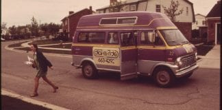 A passenger is dropped off by a dial-a-ride service in 1973.