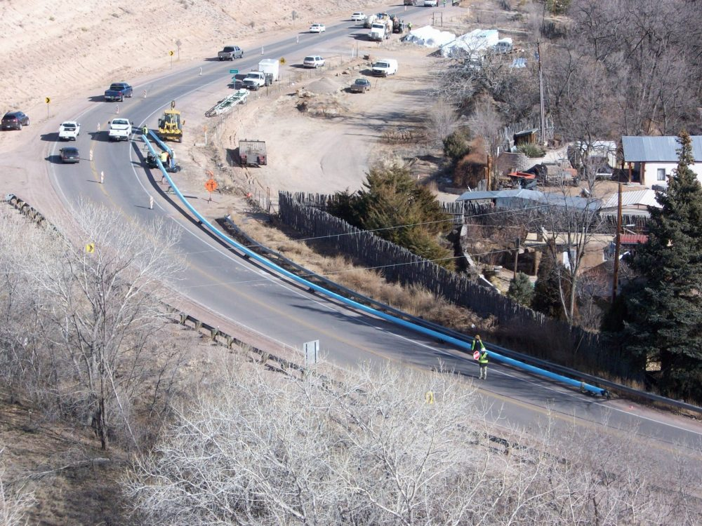 aerial view of water line under construction between two colonias; persistent poverty