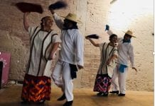 two couples dance in traditional Mexican ballet folklorico style