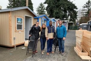 tiny houses in Tacoma, Wash., and volunteers who set them up