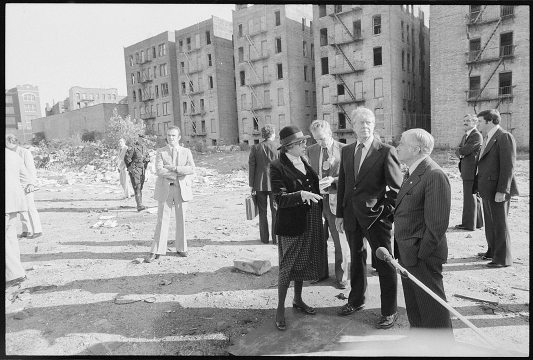 An archival photo of President Carter touring the devastated South Bronx with NYC Mayor Beame and HUD Secretary Patricia Harris in 1977.