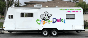 A white trailer that says Clip-n-Dales. The business is owned by a woman who was formerly incarcerated.