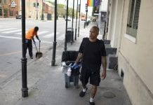 Sanitation worker Bobby Parker was illegally evicted from his home for paying his rent late. He's seen here, walking the streets of New Orleans.