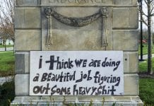 """handpainted sign says """"I think we are doing a beautiful job figuring out some heavy shit"""""""
