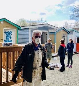 tiny houses during the pandemic. Image shows staff and volunteers at T.C. Spirit Village in Seattle