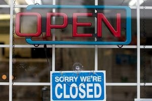 """Sign in shop window that says """"sorry we're closed""""; small-business lenders, Payroll Protection Plan, PPP"""